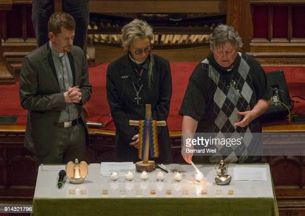 TORONTO ON FEBRUARY 4 Senior Pastor Rev Jeff Rock Rev Sam Morris and Rev Deana Dudley light the five candles one for each of the victims of serial...