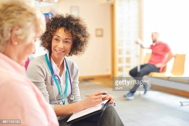 Senior patient chatting to female doctor