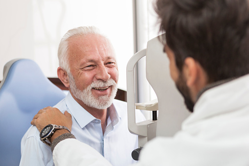 Senior Patient consulting With Optician In Office 899606214