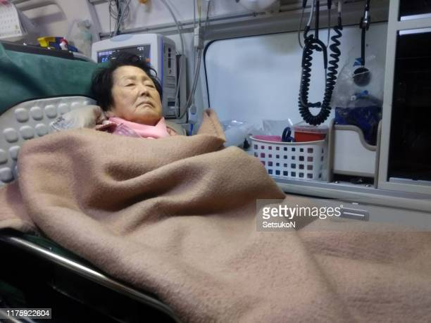 senior patient in ambulance - cardiac arrhythmia stock pictures, royalty-free photos & images