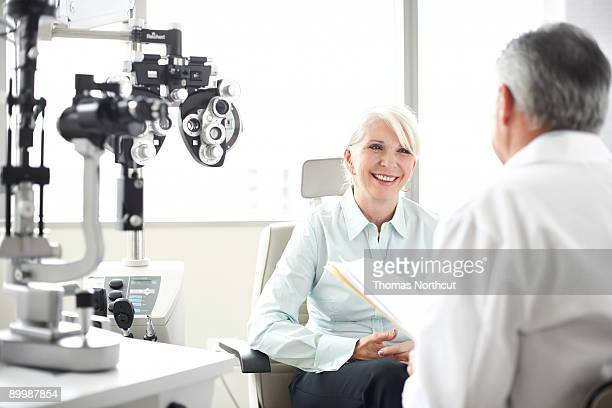 A senior patient listens to her doctor