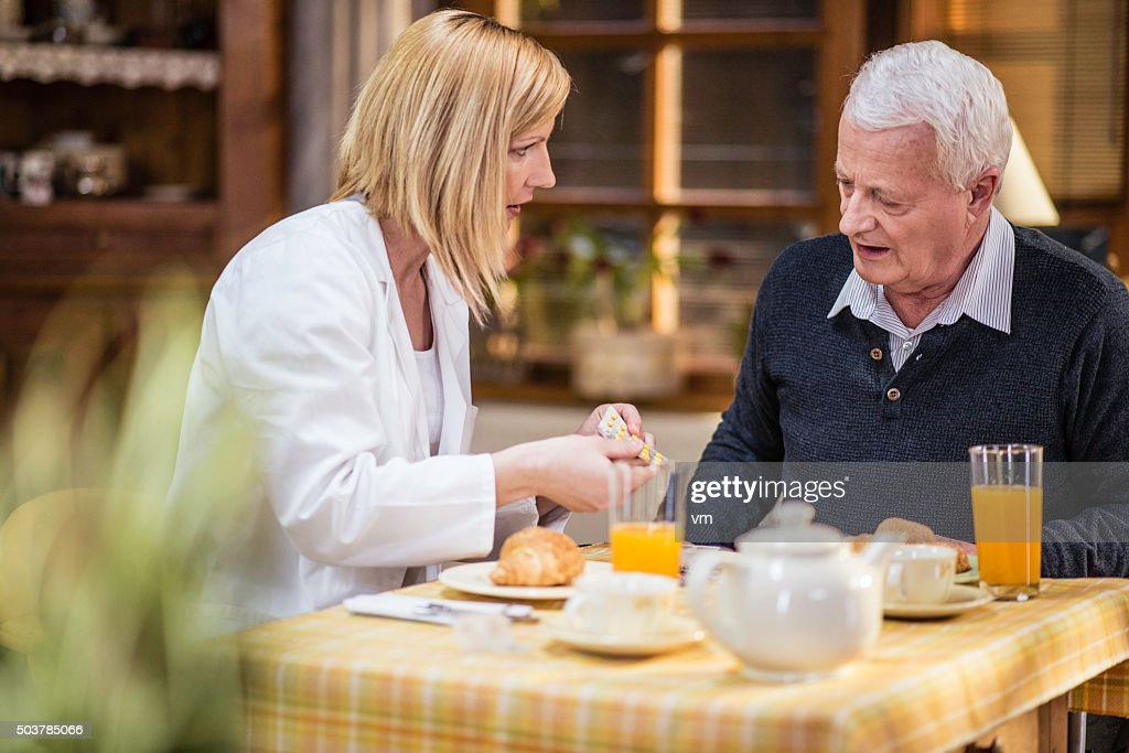 Senior patient receiving instruction from a nurse : Stock Photo