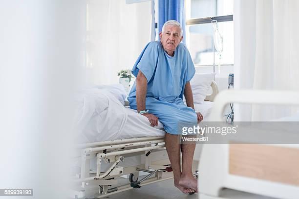 Senior patient sitting on hospital bed