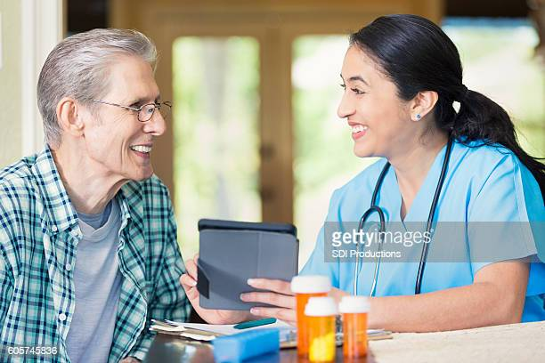 Senior patient talks with home health care nurse