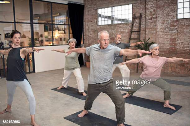 senior people coach doing yoga gym