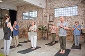 senior people fitness instructor exercising prayer
