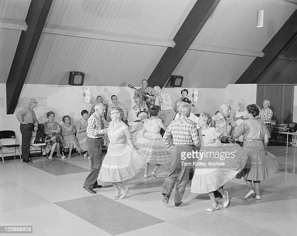 Senior people dancing in ballroom