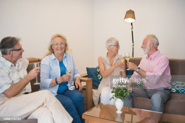 senior people drinking wine - drunk wife at party stock pictures, royalty-free photos & images