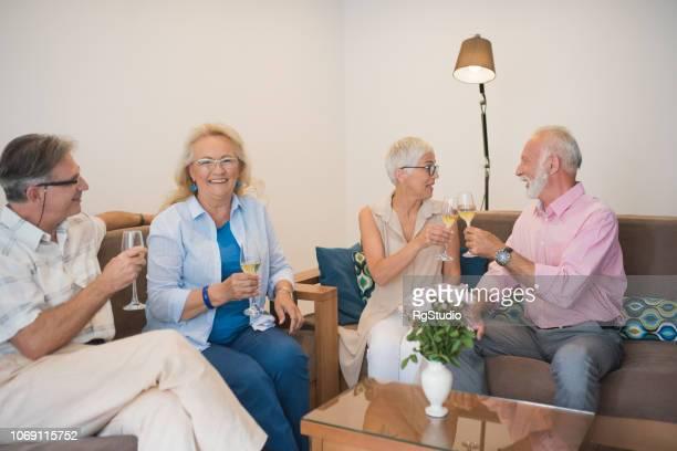 Senior people drinking wine