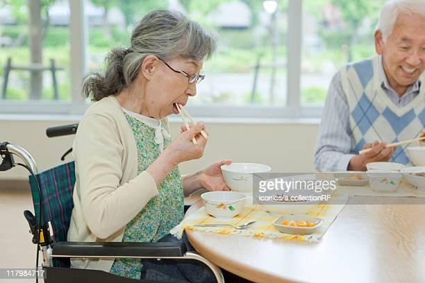 Senior People Eating in Nursing Home