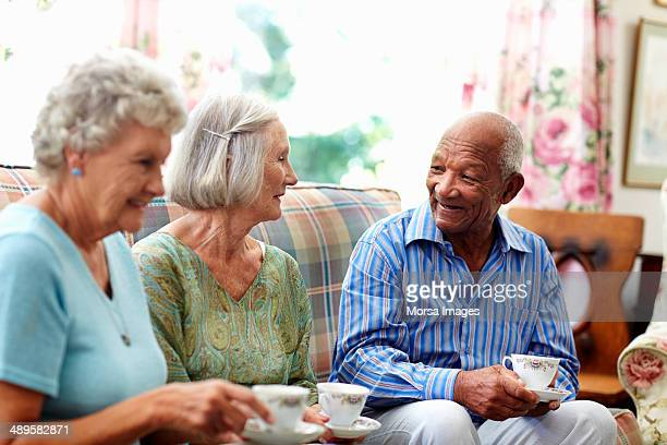 senior people having coffee - retirement community stock pictures, royalty-free photos & images