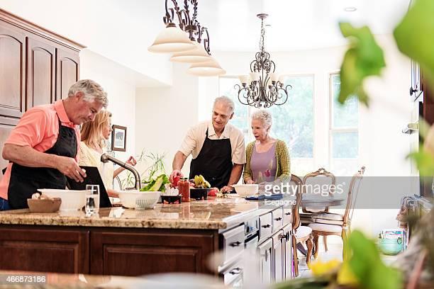 Senior people having fun in the kitchen