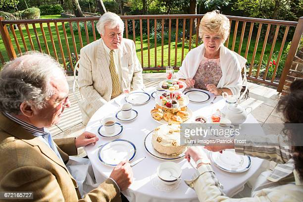 Senior people having tea on the balcony