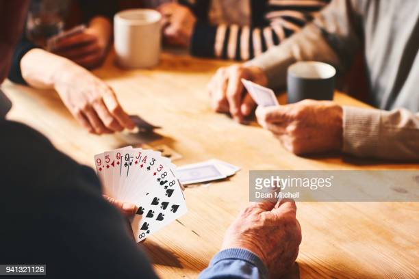 senior people playing cards - leisure games stock pictures, royalty-free photos & images