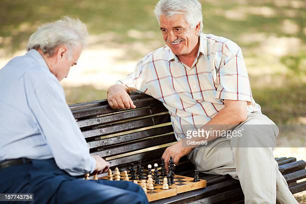 Senior people playing chess in park