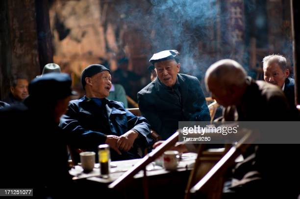 senior people relaxing in traditional tea house, chengdu, china - tea room stock pictures, royalty-free photos & images