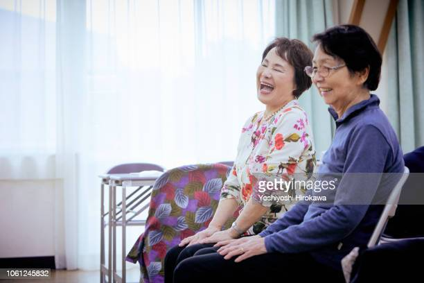 senior people talking and laugh - disruptagingcollection stock photos and pictures