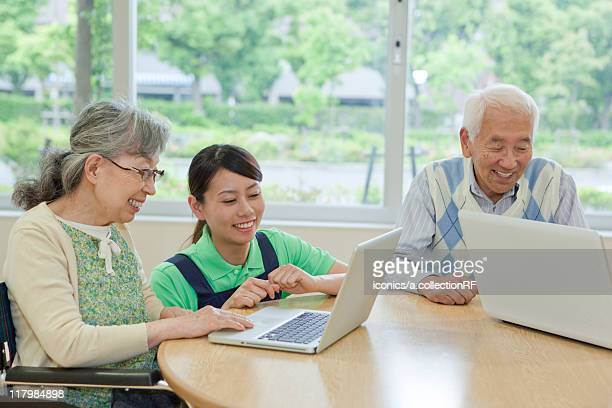 Senior people using laptop, Kanagawa Prefecture, Honshu, Japan