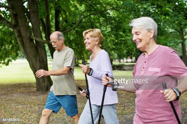 Senior people walking in park