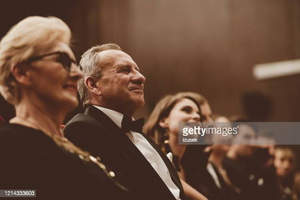 senior people watching theatrical performance - opera stock pictures, royalty-free photos & images