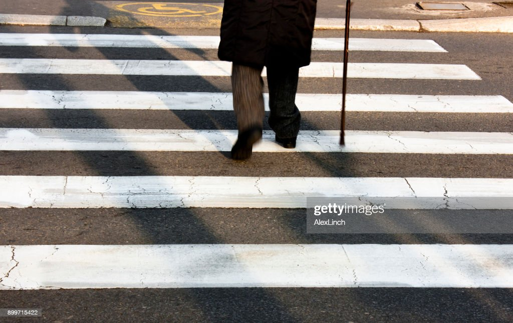 Senior person walking with a cane : Stock Photo