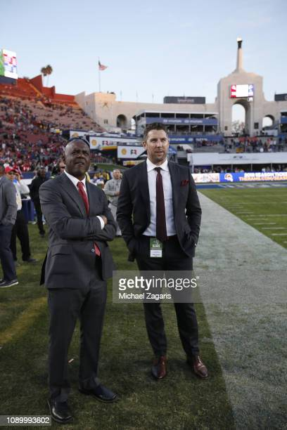 Senior Personnel Executive Martin Mayhew and Vice President of Player Personnel Adam Peters of the San Francisco 49ers stand on the sideline during...
