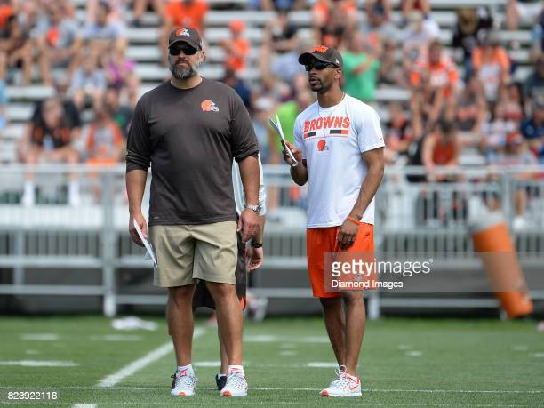 Senior personnel executive Ryan Grigson and vice president player personnel Andrew Berry of the Cleveland Browns talk on the field during a training...