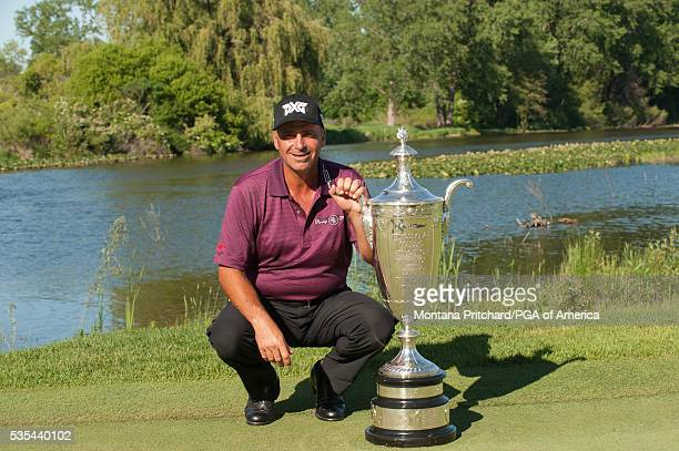 Senior PGA Championship winner Rocco Mediate poses with the Alfred S Bourne Trophy the 77th Senior PGA Championship presented by KitchenAid held at...