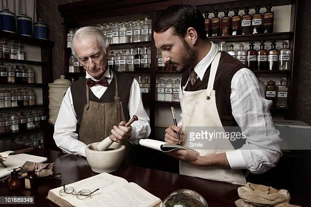 Senior pharmacist teaching his apprentice