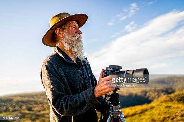 senior photographer in the australia outback. - photographer stock pictures, royalty-free photos & images