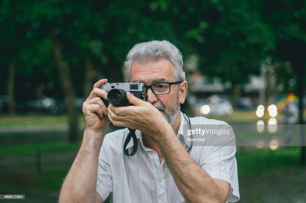 Senior photographer : Stock Photo