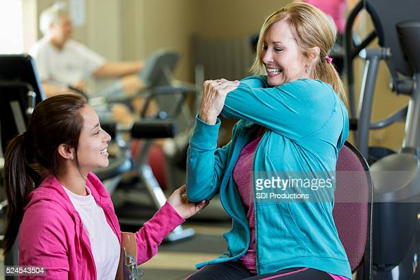Senior physical therapy client works with therapist