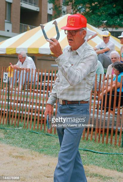A senior playing a game of horseshoes St Louis MO