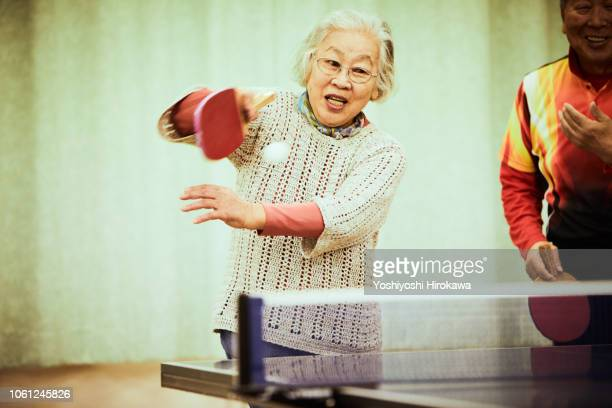 senior playing table tennis - 80 89 years stock pictures, royalty-free photos & images