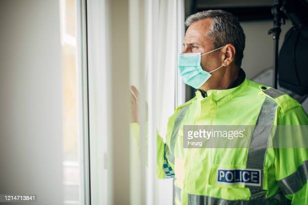 senior police officer with protective mask - police stock pictures, royalty-free photos & images