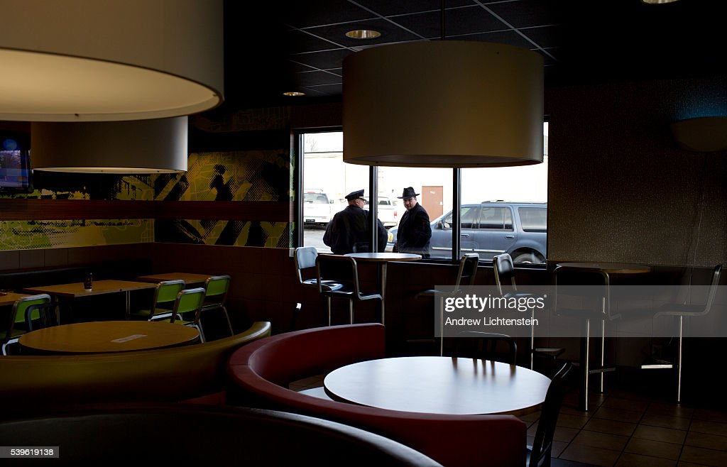 Ferguson waits for a grand jury verdict pictures getty images senior police officers after a morning meeting in mcdonalds on west florissant avenue in ferguson mozeypictures Choice Image