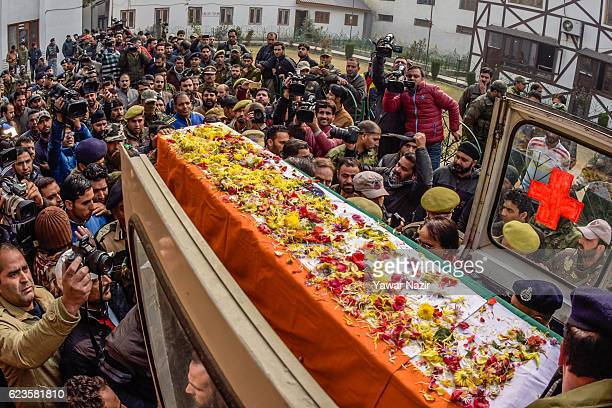 Senior police officers carry the coffin of a policeman killed by suspected militants in a gun battle during a wreath laying ceremony on November 16...