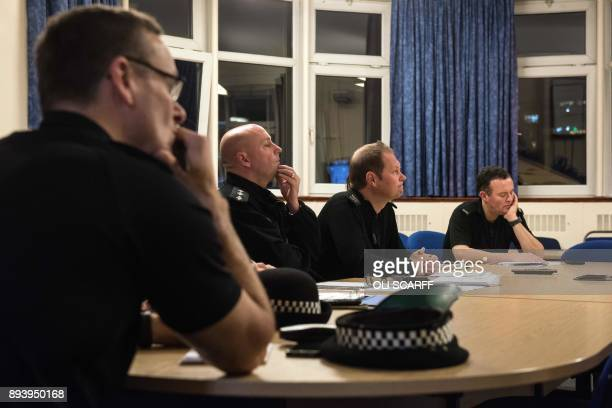 Senior police officers in Stretford Police Station conduct a briefing via videolink with the Greater Manchester Police Headquarters at Newton Heath...