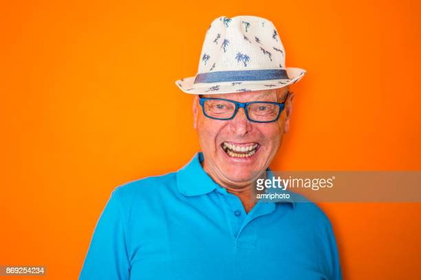 senior portrait - jolly laughing senior man - multi colored hat stock pictures, royalty-free photos & images