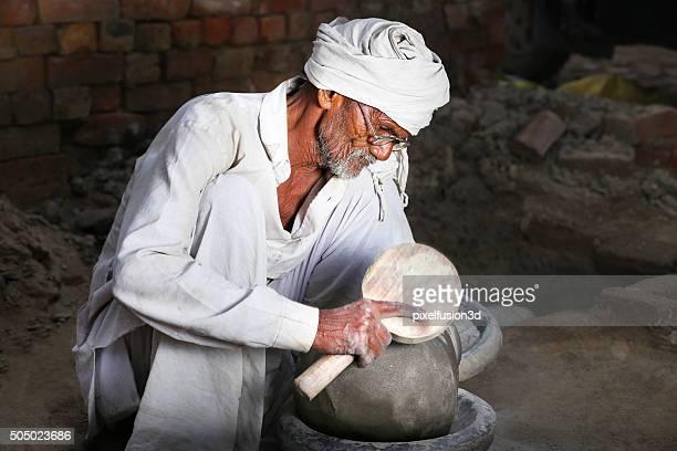 Senior Potter Making Pots