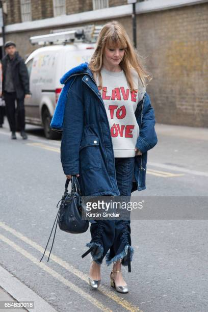 M senior print designer Kelly Harrington wears a Ganni slave to love sweater SJYP parka jacket Balenciaga bag By Mina with you shoes and Marques...