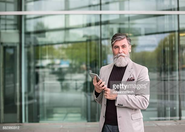 Senior professional outside office