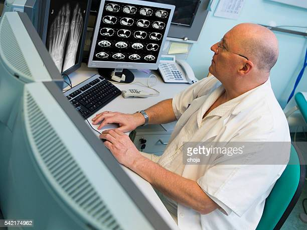 senior radiologist of oncology institute is examing mri scans - human intestine stock photos and pictures