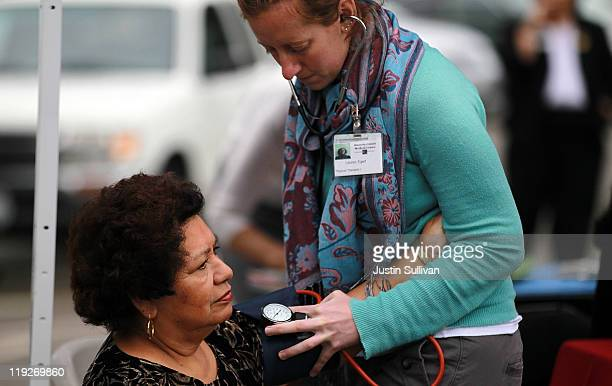A senior receives a complimentary blood pressure check during the 8th Annual Healthy Living Festival on July 15 2011 in Oakland California An...