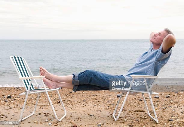 Senior relaxes on beach