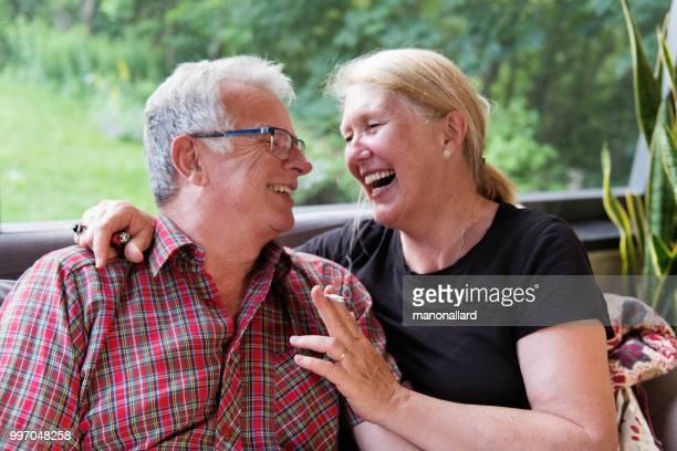 senior retired couple enjoying marijuana - smoking issues stock pictures, royalty-free photos & images
