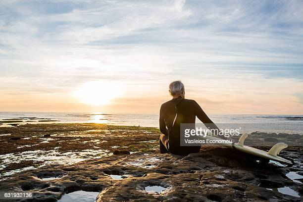 senior retired surfer man - california strong stock photos and pictures