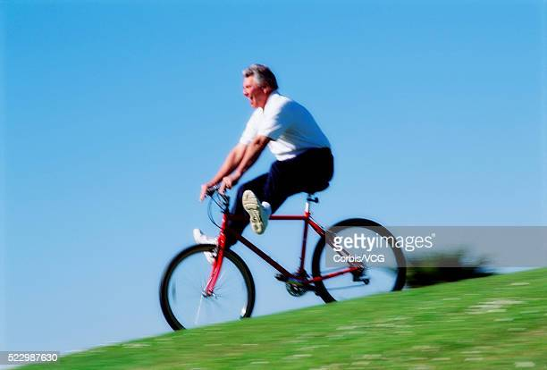 Senior Riding Bike Downhill