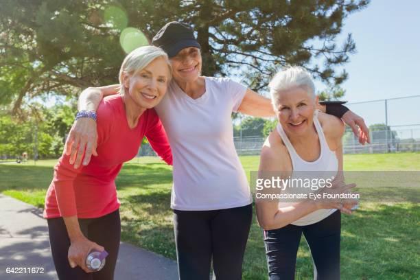Senior runners resting in park