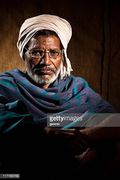 Senior, rural, Indian man wearing eyeglasses, shawl and white turban